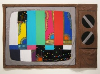 """""""Fabrication Station"""" No.1, 2015, wall sculpture (fabric, vinyl, synthetic hair and plastic barrettes), 72 in x 108 in."""
